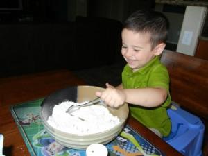 Garrett making low sugar and dairy free lemon squares.