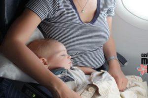 baby sleeping on plane